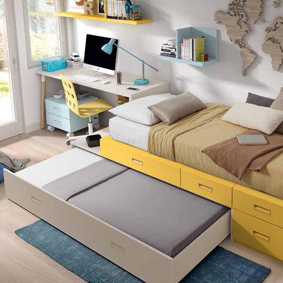 habitacion con cama amplios cajones y zona de estudio portada